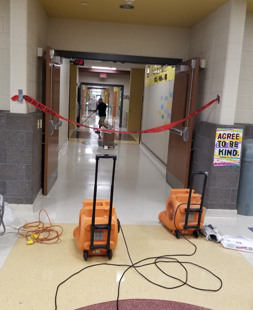 Mike Greider puts the finishing touches on the hallway floor!