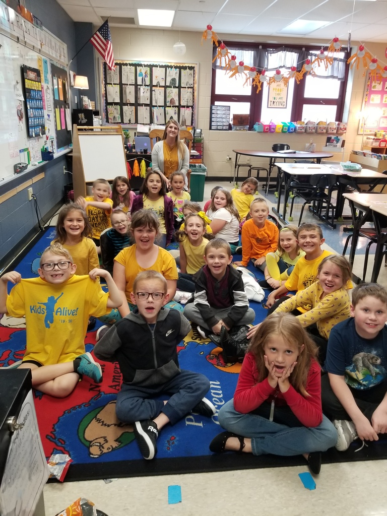 Miss Muffie's 2nd grade class showing their unity in YELLOW!